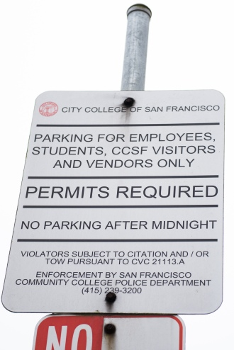 A sign looms over cars in the lower parking lot requiring permits to be purchased. Photo taken Aug 28 2017 by Otto Pippenger.