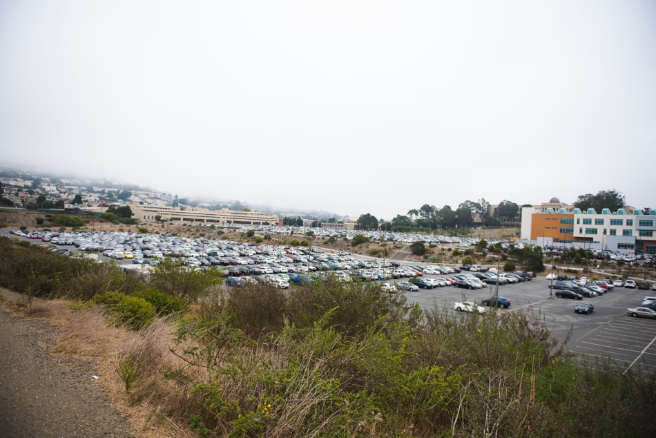 View of far end of Balboa Reservoir parking area at 9:30- out of frame portion is full. Taken Aug 28 2017 by Otto Pippenger.